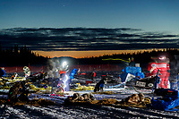 Mushers cook for their teams as dawn breaks in the early morning at the Finger Lake checkpoint on Monday, March 4, 2019 during the 2019 Iditarod.<br /> <br /> Photo by Jeff Schultz/  (C) 2019  ALL RIGHTS RESERVED