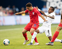 KANSAS CITY, KS - JUNE 26: Cristian Roldan #15 is challenged by Marcos Sanchez #8 during a game between United States and Panama at Children's Mercy Park on June 26, 2019 in Kansas City, Kansas.