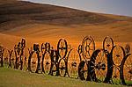 Farm fence made up of metal wheels Eastern Washington Union Town Washington State USA
