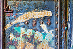 Graffiti on old steel door. Abandoned military gunnery bunkers at Fort Worden State Park, Port Townsend, WA.  Cubist, abstract, representaional.
