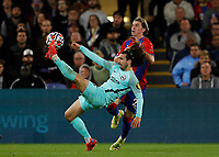 27th September 2021;  Selhurst Park, Crystal Palace, London, England; Premier League football, Crystal Palace versus Brighton & Hove Albion: Marc Cucurella of Brighton clears the ball out over Conor Gallagher of Crystal Palace