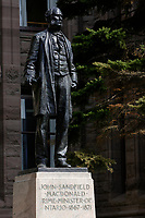 Toronto (ON) CANADA - April 24 2008 File Photo.Statue of John Sandfield - MacDonald, Prime-Minister of Ontario (1876-1871) in front of the Legislative Assembly of Ontario in. Queens Park ( in the Downtown area of Toronto)... Opened in 1860 by Edward, Prince of Wales, it was named in honour of Queen Victoria. The park is the site of the Ontario Legislature, which houses the Legislative Assembly of Ontario, and so the phrase Queen's Park is also frequently used to refer to the Government of Ontario.