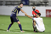CARY, NC - AUGUST 01: Alex Crognale #21 is helped up by Conor Donovan #20 and Maggi Campanaro during a game between Birmingham Legion FC and North Carolina FC at Sahlen's Stadium at WakeMed Soccer Park on August 01, 2020 in Cary, North Carolina.