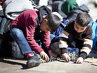 Pictured: Children play at the port Thursday 03 March 2016<br /> Re: Migrants have been gathering at the port of Piraeus, near Athens, Greece