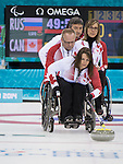 Sochi, RUSSIA - Mar 15 2014 - Ina Forrest, Dennis Thiessen and Sonja Gaudet as Canada takes on Russia in the Gold Medal Wheechair Curling match at the 2014 Paralympic Winter Games in Sochi, Russia.  (Photo: Matthew Murnaghan/Canadian Paralympic Committee)