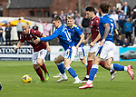 Arbroath v St Johnstone…15.08.21  Gayfield Park      Premier Sports Cup<br />Nicky Low battles with Glenn Middleton<br />Picture by Graeme Hart.<br />Copyright Perthshire Picture Agency<br />Tel: 01738 623350  Mobile: 07990 594431