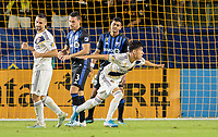 CARSON, CA - SEPTEMBER 21: Uriel Antuna #18 of the Los Angeles Galaxy scores his goal and celebrates during a game between Montreal Impact and Los Angeles Galaxy at Dignity Health Sports Park on September 21, 2019 in Carson, California.
