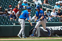 Jake Cronenworth (1) of the Durham Bulls slaps hands with Durham Bulls manager Brady Williams (4) as he rounds third base after hitting a home run against the Charlotte Knights at BB&T BallPark on May 27, 2019 in Charlotte, North Carolina. The Bulls defeated the Knights 10-0. (Brian Westerholt/Four Seam Images)