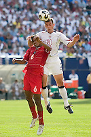 USA's Brad Davis heads the ball over Panama's Gabriel Gomez. The United States defeated Panama 3-1 in a shoot out after a scoreless game to win the CONCACAF Gold Cup at Giant's Stadium, East Rutherford, NJ, on July 24, 2005.