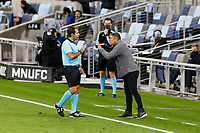 ST PAUL, MN - SEPTEMBER 9: Luchi Gonzalez head coach of FC Dallas talks with a \ referee during a game between FC Dallas and Minnesota United FC at Allianz Field on September 9, 2020 in St Paul, Minnesota.