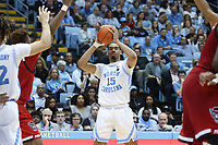 CHAPEL HILL, NC - FEBRUARY 25: Garrison Brooks #15 of the University of North Carolina looks for a teammate to pass the ball to during a game between NC State and North Carolina at Dean E. Smith Center on February 25, 2020 in Chapel Hill, North Carolina.
