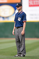Derek Crabill handles the umpire duties at first base during an International League game between the Syracuse Chiefs and the Charlotte Knights at Knights Castle May 3, 2009 in Fort Mill, South Carolina. (Photo by Brian Westerholt / Four Seam Images)
