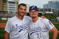 Pensacola Blue Wahoos Donald Lutz (34) and Nick Travieso (21) pose for a photo after a game against the Birmingham Barons on May 2, 2016 at Regions Field in Birmingham, Alabama.  Pensacola defeated Birmingham 6-3.  (Mike Janes/Four Seam Images)