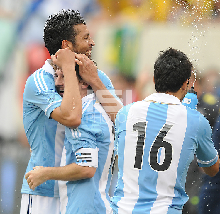 Argentina forward Lionel Messi (10) celebrates with teammates his score in the 84th minute of the game with teammate Pablo Guinazu.  The Argentina National Team defeated Brazil 4-3 at MetLife Stadium, Saturday July 9 , 2012.