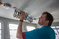 Selects proper sunglasses to aid in fish observation during the Sitka Sound Herring Fishery.