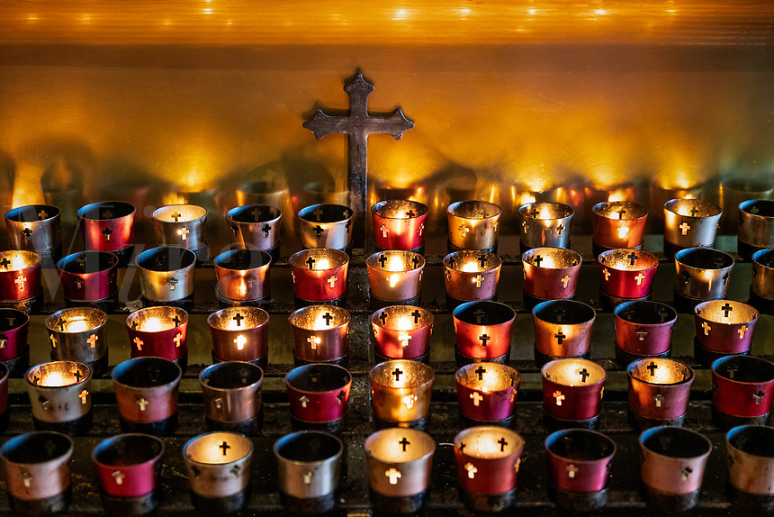 Votive candles in a Catholic devotional chapel.