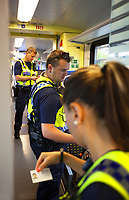 Switzerland. Canton Ticino. Three police officers from TPO (Transport Police) Two policemen and a policewoman control the train tickets' validity of passengers travelling on a TILO train between Lugano and Chiasso. TPO (Transport Police) is the Swiss Federal Railways Police. Swiss Federal Railways (German: Schweizerische Bundesbahnen (SBB), French: Chemins de fer fédéraux suisses (CFF), Italian: Ferrovie federali svizzere (FFS)) is the national railway company of Switzerland. It is usually referred to by the initials of its German, French and Italian names, as SBB CFF FFS. TILO (Treni Regionali Ticino Lombardia) creates efficient train connections between the towns in the canton Ticino.12.06.2017 © 2017 Didier Ruef