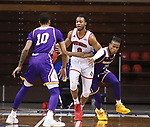 SIOUX FALLS, SD - MARCH 6: Ramean Hinton #23 of the Western Illinois Leathernecks reaches on Stanley Umude #0 of the South Dakota Coyotes during the Summit League Basketball Tournament at the Sanford Pentagon in Sioux Falls, SD. (Photo by Richard Carlson/Inertia)