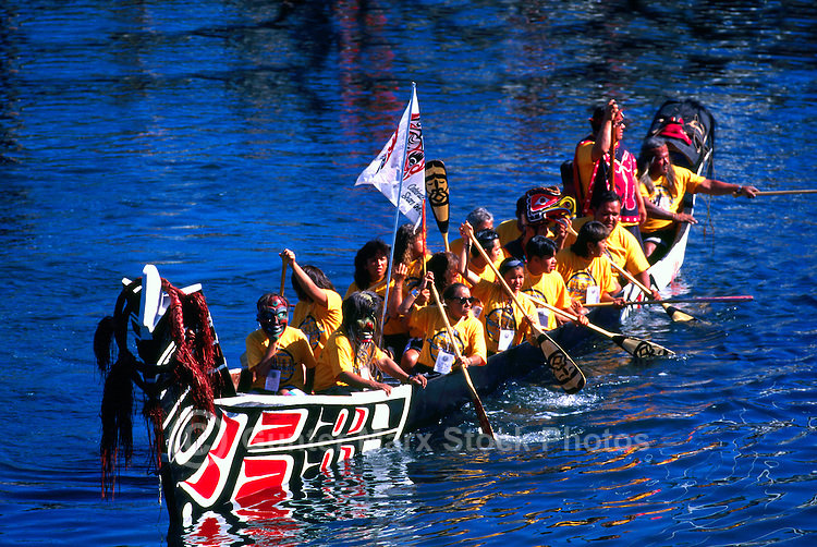 Native American Indians canoeing in Traditional Sea-going Dugout War Canoe at Indigenous Games, Victoria, BC, British Columbia, Canada