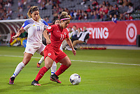 CARSON, CA - FEBRUARY 07: Raquel Rodriguez #11 of Costa Rica defends against  Desiree Scott #11 of Canada during a game between Canada and Costa Rica at Dignity Health Sports Park on February 07, 2020 in Carson, California.