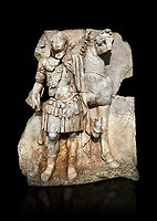 Roman Sebasteion relief sculpture of  an Imperial prince as Diokouros son of zeus, Aphrodisias Museum, Aphrodisias, Turkey.   Against a black background.<br /> <br /> An imperial youth wearing a military cloak and cuirass of a commander holds the reins of hios horse. This panel is next to a Claudius panel so is probably of Britanicus or Nero the emperors son and intended successor