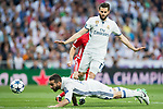 Daniel Carvajal Ramos of Real Madrid heads the ball as teammate Nacho Fernandez of Real Madrid looks on during their 2016-17 UEFA Champions League Quarter-finals second leg match between Real Madrid and FC Bayern Munich at the Estadio Santiago Bernabeu on 18 April 2017 in Madrid, Spain. Photo by Diego Gonzalez Souto / Power Sport Images