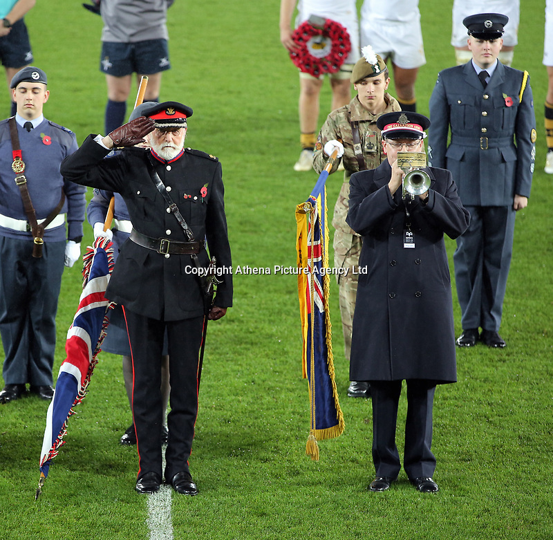 Members of the armed forces observe a minute's silence with players and officials before kick off during the Anglo-Welsh Cup match between Ospreys and Wasps at The Liberty Stadium, Swansea, Wales, UK. Friday 10 November 2017
