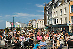 Margate Kent The Parade tourist Sunday afternoon enjoy free musical entertainment The Turner Contemporary Art gallery in background.