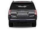 Straight rear view of a 2015 GMC Yukon Xl Sle 5 Door Suv 2WD Rear View  stock images