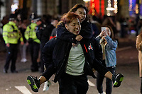 Pictured: A young woman rides piggyback in Swansea. Tuesday 31 December 2019 to Wednesday 01 January 2020<br /> Re: Revellers on a night out for New Year's Eve in Wind Street, Swansea, Wales, UK.