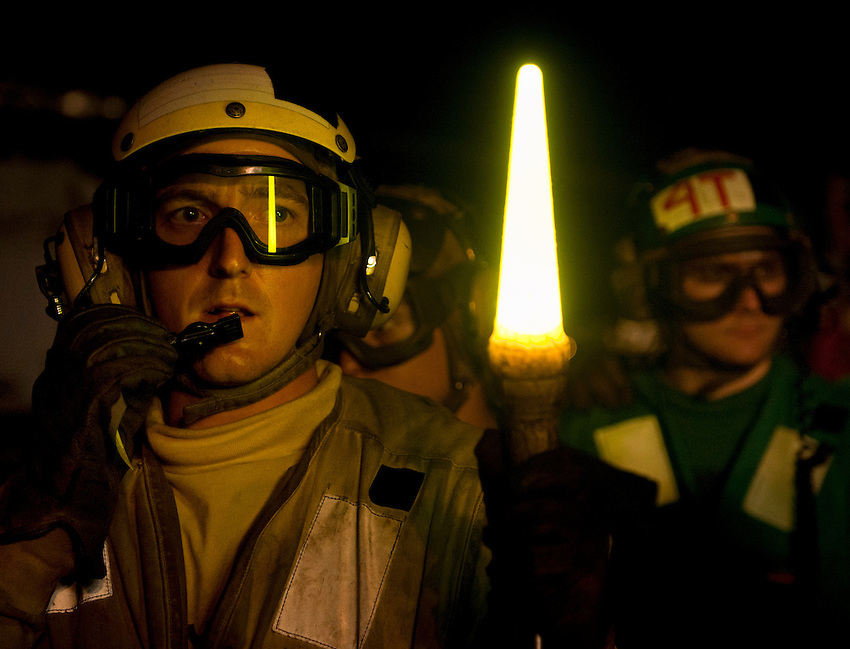 110604-N-DR144-435 PACIFIC OCEAN (June 4, 2011) Aviation Boatswain's Mate (Handling) 3rd Class Jeffrey Mullins coordinates the response to a simulated aircraft fire while acting as the scene leader during crash and salvage drills on the flight deck of the Nimitz-class aircraft carrier USS Carl Vinson (CVN 70).  Carl Vinson and Carrier Air Wing (CVW) 17 are underway in the U.S. 3rd Fleet area of responsibility. (U.S. Navy photo by Mass Communication Specialist 2nd Class James R. Evans / Released)....
