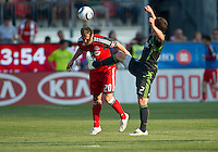 Seattle Sounders FC midfielder Mike Fucito #2 and Toronto FC defender Ty Harden #20 in action during an MLS game between the Seattle Sounders FC and the Toronto FC at BMO Field in Toronto on June 18, 2011.