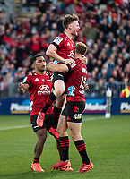 Mitchell Drummond (centre) celebrates with Braydon Ennor (right) and Sevu Reece during the 2020 Super Rugby match between the Crusaders and Highlanders at Orangetheory Stadium in Christchurch, New Zealand on Saturday, 9 August 2020. Photo: Joe Johnson / lintottphoto.co.nz