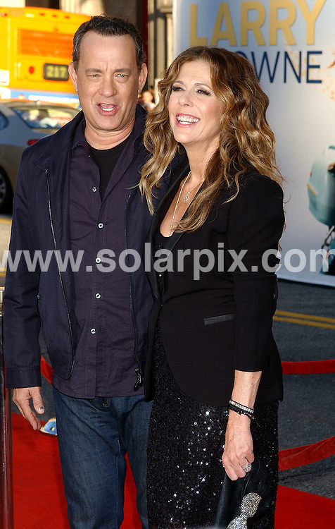 **ALL ROUND PICTURES FROM SOLARPIX.COM**                                 **NO SYNDICATION IN USA** .Premiere of new movie, Larry Crowne at the Graumans Chinese Theatre in Hollywood, Ca. on June 27, 2011.                     .This pic:     Tom Hanks & Rita Wilson                                                                                      JOB REF:    13635    GLS       DATE:    28.06.11                                                         **MUST CREDIT SOLARPIX.COM OR DOUBLE FEE WILL BE CHARGED**                                                                        **MUST NOTIFY SOLARPIX OF ONLINE USAGE**                 **CALL US ON: +34 952 811 768 or LOW RATE FROM UK 0844 617 7637**