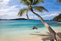 Playing on a tire swing<br /> Gibney Beach<br /> Virgin Islands National Park<br /> St. John<br /> U.S. Virgin Islands