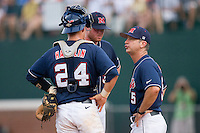 Ole Miss Rebels head coach Mike Bianco #5 has a chat with pitcher Aaron Barrett #30  and catcher Miles Hamblin #24 at the Charlottesville Regional of the 2010 College World Series at Davenport Field on June 5, 2010, in Charlottesville, Virginia.  The Cavaliers defeated the Rebels 13-7.  Photo by Brian Westerholt / Four Seam Images