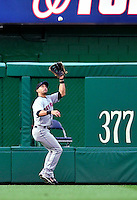 30 September 2009: New York Mets' center fielder Angel Pagan pulls in a fly ball against the Washington Nationals at Nationals Park in Washington, DC. The Nationals rallied in the bottom of the 9th inning on Justin Maxwell's walk-off Grand Slam to win 7-4 and sweep the Mets 3-game series capping the Nationals' 2009 home season. Mandatory Credit: Ed Wolfstein Photo
