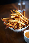 Hand cut french fries with dipping sauce.
