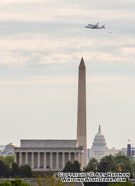 NASA Space Shuttle Discovery arrives at Washington, DC, where it flew over the Washington Monument. I was on the Virginia bank of the Potomac river to capture this moment in history.