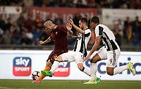 Calcio, Serie A: Roma vs Juventus. Roma, stadio Olimpico, 14 maggio 2017. <br /> Roma's Radja Nainggolan, left, kicks to score as Juventus' Miralem Pjanic, center, and Mehdi Benatia try to stop him during the Italian Serie A football match between Roma and Juventus at Rome's Olympic stadium, 14 May 2017. Roma won 3-1.<br /> UPDATE IMAGES PRESS/Isabella Bonotto