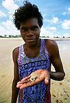 Tiwi man explores tidepools of Melville Island, Australia
