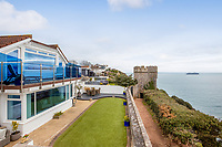 BNPS.co.uk (01202) 558833. <br /> Pic: Stags/BNPS<br /> <br /> Wealthy staycationers are expected to line up to buy a luxury holiday home that has one of the finest views of the English Riviera. <br /> <br /> Redlands is a four bedroom house that sits on a cliff top in one of Torquay's most exclusive and prestigious areas, Rock End.<br /> <br /> The living room and garden have the most jaw-dropping views of Tor Bay and the South West Coast Path.