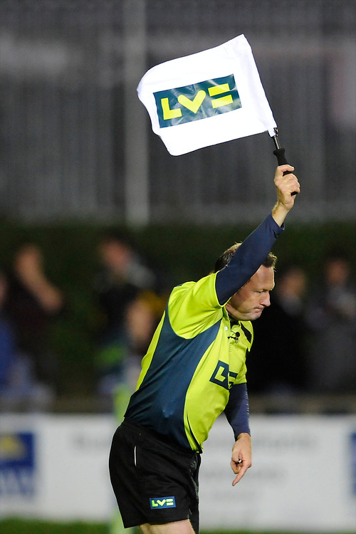 Corporate branding on the Assistant Referee's flag during the LV= Cup second round match between Ospreys and Northampton Saints at Riverside Hardware Brewery Field, Bridgend (Photo by Rob Munro)