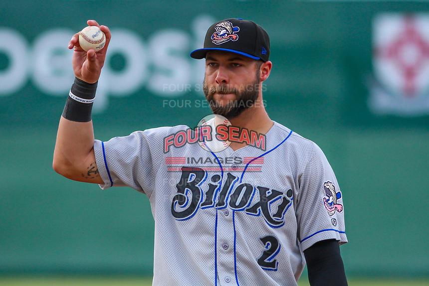 Biloxi Shuckers first baseman Weston Wilson (2) tosses a ball to the dugout between innings of a Southern League game against the Jackson Generals on June 14, 2019 at The Ballpark at Jackson in Jackson, Tennessee. Jackson defeated Biloxi 4-3. (Brad Krause/Four Seam Images)