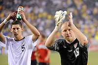 goalkeeper Brad Guzan (18) and Omar Gonzalez (5) of the United States salutes the fans after the game. The men's national team of Brazil (BRA) defaeted the United States (USA) 2-0 during an international friendly at the New Meadowlands Stadium in East Rutherford, NJ, on August 10, 2010.