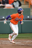 First baseman Dylan Brewer (3) of the Clemson Tigers runs toward first in a game against the Stony Brook Seawolves on Friday, February 21, 2020, at Doug Kingsmore Stadium in Clemson, South Carolina. Clemson won, 2-0. (Tom Priddy/Four Seam Images)