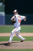 Baltimore Orioles pitcher Logan Verrett (64) during a Spring Training game against the Tampa Bay Rays on March 14, 2015 at Ed Smith Stadium in Sarasota, Florida.  Tampa Bay defeated Baltimore 3-2.  (Mike Janes/Four Seam Images)