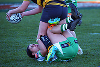 Manawatu's Janna Michal Vaughan makes a tackle during the Farah Palmer Cup women's rugby match between Manawatu Cyclones and Taranaki Whio at CET Stadium in Palmerston North, New Zealand on Saturday, 24 July 2021 Photo: Dave Lintott / lintottphoto.co.nz