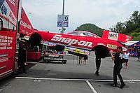 Jun. 17, 2011; Bristol, TN, USA: Crew members lift the body of the car driven by NHRA funny car driver Cruz Pedregon during qualifying for the Thunder Valley Nationals at Bristol Dragway. Mandatory Credit: Mark J. Rebilas-