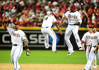 Apr. 6, 2012; Phoenix, AZ, USA; Arizona Diamondbacks outfielder Justin Upton (right) leaps in the air to celebrate with third baseman (14) Ryan Roberts following the game against the San Francisco Giants during opening day at Chase Field.  The Diamondbacks defeated the Giants 5-4. Mandatory Credit: Mark J. Rebilas-